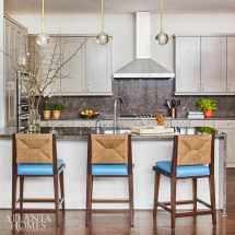Howard dressed up the kitchen with Palecek stools and pendants from Arteriors.