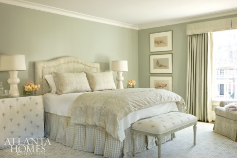 The homeowner's favorite hues, French blue and cream, envelope the master bedroom.