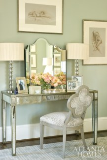 A collection of Terry Reitzel sketches and a mirrored dressing table lend an elegant flourish.