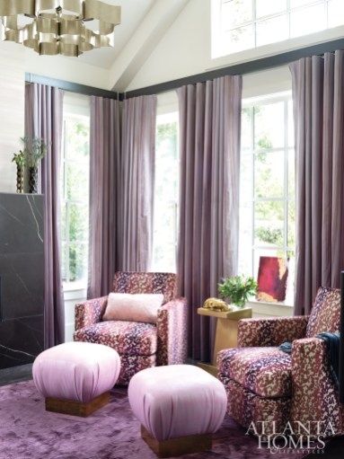 In a room used primarily for prayer and reflection, Kong employed an energetic fabric on a pair of lounge chairs. The antique brass accent table is by Noir Furniture, and the pink shagreen stools are from Worlds Away.