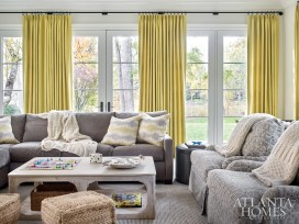 Chartreuse draperies by Arabel Linens and throw pillows by Raoul Textiles, all made by Douglass Workroom, brighten the sunroom.