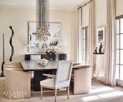 In contrast to the dining table's dark finish and sturdy shape, Brown selected barrel-back dining chairs from A. Rudin and host and hostess chairs by Jiun Ho, through R Hughes.