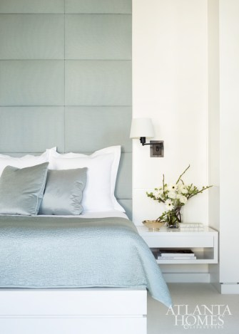 A headboard upholstered in wool by Gretchen Bellinger softens the handsome architectural elements in the master suite.