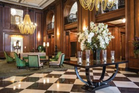 The hotel's warm-but-opulent lobby appears both vintage 1920s and modern at once.