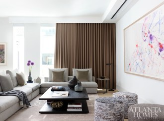 A recessed projector screen allows an abstract painting by Sam Francis to inject the media room with color and movement when the TV is not in use.