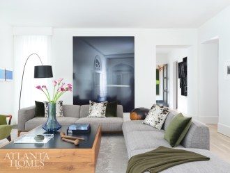 A large-scale photograph by James Casebere anchors the living room, where the Wielands entertain guests. Interior designer Julie Witzel and Skylar Morgan Furniture custom-designed the coffee table.
