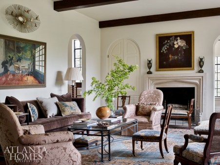 The living room houses a mix of antiques, a new Ferrell Mittman sofa and a redesigned mantel. Beams lend additional character. The pair of armchairs are from Brunschwig & Fils and are covered in Nancy Corzine fabric. The painting above the sofa is from Tew Galleries.