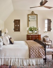 The master bedroom includes a Louis J. Solomon bed, bedding from Gramercy and pillows from Holland & Sherry.