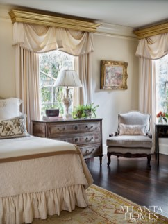 New gilt cornices in the master bedroom offer a regal touch.