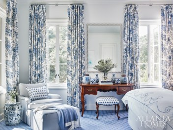 The drapery fabric by Raoul Textiles inspired the design of the guest bedroom, complementing the wall-to-wall carpet from Stark and the bedding from Julia B. The chair is re-covered in fabric from Jane Churchill.