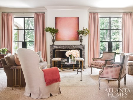 A painting by Katharina Chapuis through Pryor Fine Art takes center stage in the formal living room. The modern curved-back chair is Rose Tarlow through Jerry Pair, and it's covered in a metallic fabric with a scalloped skirt by Nancy Corzine.