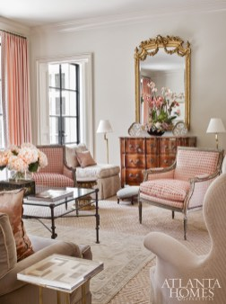 An Oushak rug layered atop a large sisal fosters an intimate feeling in the formal living room, which features a mix of antiques alongside new pieces, such as a brass table with a Lucite top by Lucy Smith through Holland MacRae.
