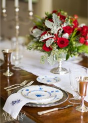 The dining room is holiday party-ready with silver goblets from Beverly Bremer Silver Shop and Herend's Chinese Bouquet in blue available through Neiman Marcus.