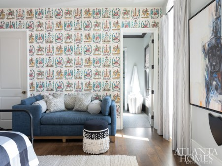 Shades of blue, white and yellow harmonize in the youngest son's room. Johnson enlisted the help of the 5-year old in selecting the battle-themed wallpaper by Brunschwig & Fils. The dog painting is from Wendover Art Group.