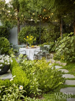 Howard Design Studio turned a little used space of the backyard into a dining area for casual lunches and dinners. The table and chairs are manufactured in France for Fermob.