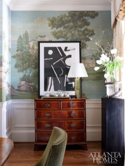 A custom DeGournay wallcovering enlivens the space.