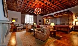 A cardinal suite at the Parador Santiago de Compostela.