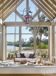 Because the property sits at a bow in the lake, Adams took advantage of the site and angled the home's footprint so that each room of the house, including this screened porch, offers views of the water.