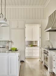 The kitchen's layout and flow is a study in smart space-planning. Two islands provide space for food prep and dining, while a working pantry, butler's pantry and bar are tucked away behind the range. Concealed storage—in the form of retractable slabs located in the backsplash on both sides of the range— hide spices and oils.