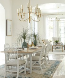"""Designers Nina Nash Long and Don Easterling sourced open fretwork chairs and a painted table from Mathews Furniture + Design to give the dining space """"breathing room."""""""