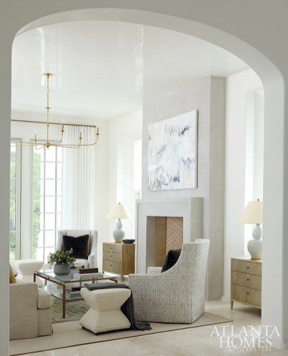 """Calm colors and textures envelope the great room. """"We wanted it to feel tranquil, so we kept the hues very soft using whites, pale blues and light wooden tones,"""" says Easterling. The ceilings and walls are Venetian plaster that was applied by hand, nodding to the Alys Beach aesthetic."""