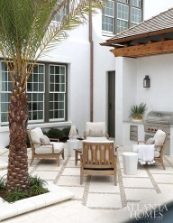 Teak chairs hold court outside the luxurious courtyard and pool.