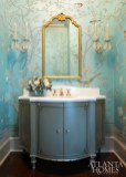 Suzanne Kasler selected a de Gournay paper for a powder room that highlights colors used in nearby spaces. Photo by Erica George Dines