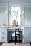 """Symmetry reigns in the master bathroom. """"When color is involved, symmetrical cabinetry and windows can have a calming effect on a room,"""" Ingram explains."""