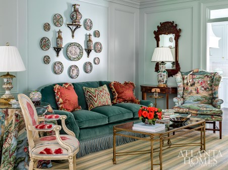 There's no such thing as too much chinoiserie, says Mathison Glenn, who used the motif throughout the home. In the living room, it makes an appearance by way of Harriet's beloved skirted table and wingback chair. The designer took the discontinued Clarence House print to ADAC and other venues to pull together the additional items in the room. Elements like the aqua walls and striped jute rug update the numerous family antiques.