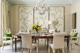 """Angela Bromenschenkel's main goal in the dining room was to create a """"dining in the garden"""" environment. The ceiling is painted in Sherwin-Williams' Sea Salt to resemble the sky, while garden panels by Mary Frances Estock reflect scenes from nature. And when the French doors are open, """"If you close your eyes and feel the breeze, you're immediately transported,"""" she says."""