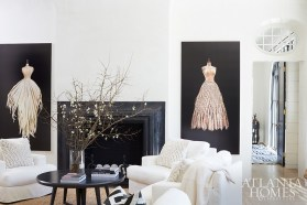 A pair of large-scale paintings by Atlanta artist Todd Murphy anchors a fireplace, adding an element of movement to a living room by Melanie Turner and Stan Benecki.