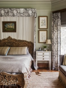 In the master bedroom, sage green walls provide a soothing backdrop while a grouping of botanical prints references the couple's love of nature. A toile Lee Jofa fabric depicting a wildlife scene has a similar effect.