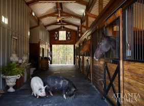 The couple renovated and added on to the property's existing stable, and the wife enjoys riding horses as part of her daily routine. Recently, they also welcomed potbelly pigs Milly and Bubba to their brood.
