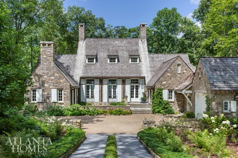 Built with native North Carolina fieldstone, this handsome retreat is a collaboration betweenarchitect D. Stanley Dixon, landscape architect John Howard and Betty Burgess of Betty Burgess Design.