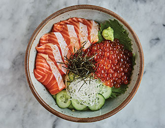 Salmon Donburi with cucumber and salmon roe.