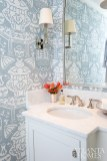The serene chinoiserie theme continues into the powder room.