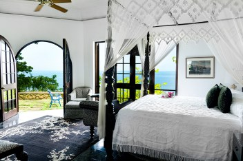 Overlooking the ocean, each villa is designed with Jamaican antiques.