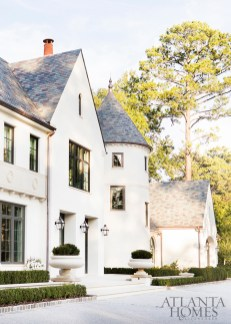 """An iconic addition to one of Atlanta's most tony avenues, the French Normandy abode is clad with stucco over masonry with limestone detailing and a distinct turret that """"feels right,"""" says Harrison Design architect Greg Palmer."""