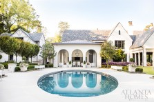 Designed for indoor-outdoor living, the home boasts a spacious covered patio, beautifully landscaped yard by John Howard of Howard Design Studio and a round swimming pool.