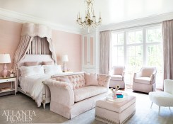 The old idiom, pretty in pink, applies to the teenage daughter's bedroom, which features a wallcovering from Phillip Jeffries, blush drapery fabric by Kravet and coordinating upholstered furnishings.