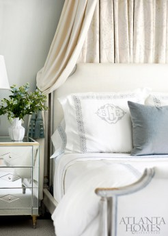 Mirrored nightstands by Suzanne Kasler for Hickory Chair flank a maple-framed bed by Ferrell Mittman in one of the two teenage daughter's bedrooms.