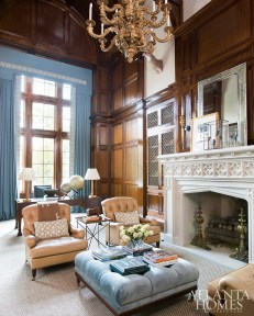 The two-story library features plaster walls and wood paneling by Block & Chisel.