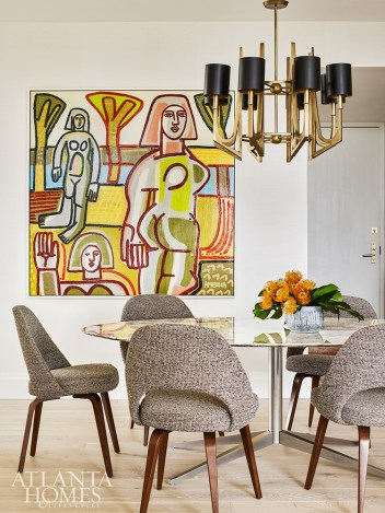 A neutral base palette allows colorful artwork by America Martin through Tew Galleries to pop in the dining area.