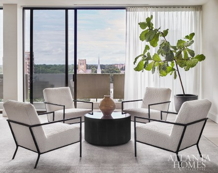 The living room offers sweeping views of Atlanta's Peachtree Heights neighborhood. The four armchairs are Lee Industries through UpCountry Home.