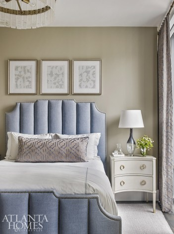 Flanked by side tables from Somerset Bay, a channeled upholstered headboard by Bernhardt introduces a splash of subtle color in the guest bedroom.