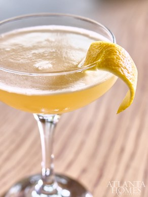The Bees Knees with gin and a lemon peel for garnish is a cocktail classic.