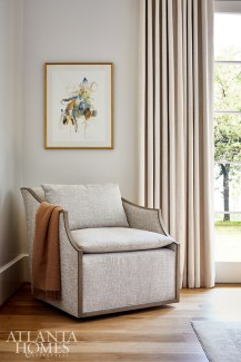 A chair by Lee Industries creates an inviting place to sit by a window.