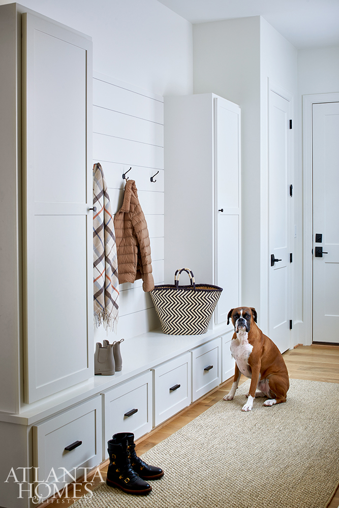 A runner by Glover and Flack softens the mudroom entry where the family dog and his owners can leave coats, boots, leashes and school bags.