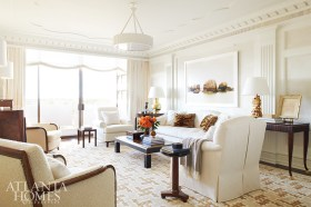 Designer Jim Howard's classical sensibilities are on display through both the millwork and sofa he designed in the living room. To keep the space from reading overly traditional, Phoebe Howard selected a fine art photograph by Josef Hoflehner through Jackson Fine Art. The coffee table and side tables were purchased by the couple in France.