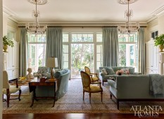 Comfort and hospitality were paramount, accomplished in the living room with multiple seating areas. Three sets of French doors open onto the rear porch to allow circulation between indoors and out. Homeowner Susan Morrow selected furnishings that captured the essence of the Lowcountry.